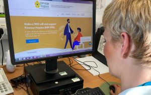 Helen Watson from Primrose Hospice looking at the Guardian Angel Will writing website for Make A Will Month 2020