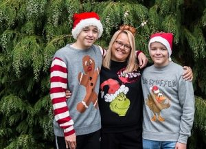 A family help promote Christmas Jumper Day in aid of Primrose Hospice