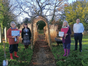 Primrose Hospice gardening volunteers awarded with certificate and flowers