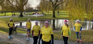 Sharon Johnson and team members of #WMPMND at Sanders Park, Bromsgrove taking part in Primrose Hospice's Santa Fun Run