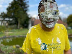 Primrose Hospice CEO David Burrell with the remenants of custard pie on his face