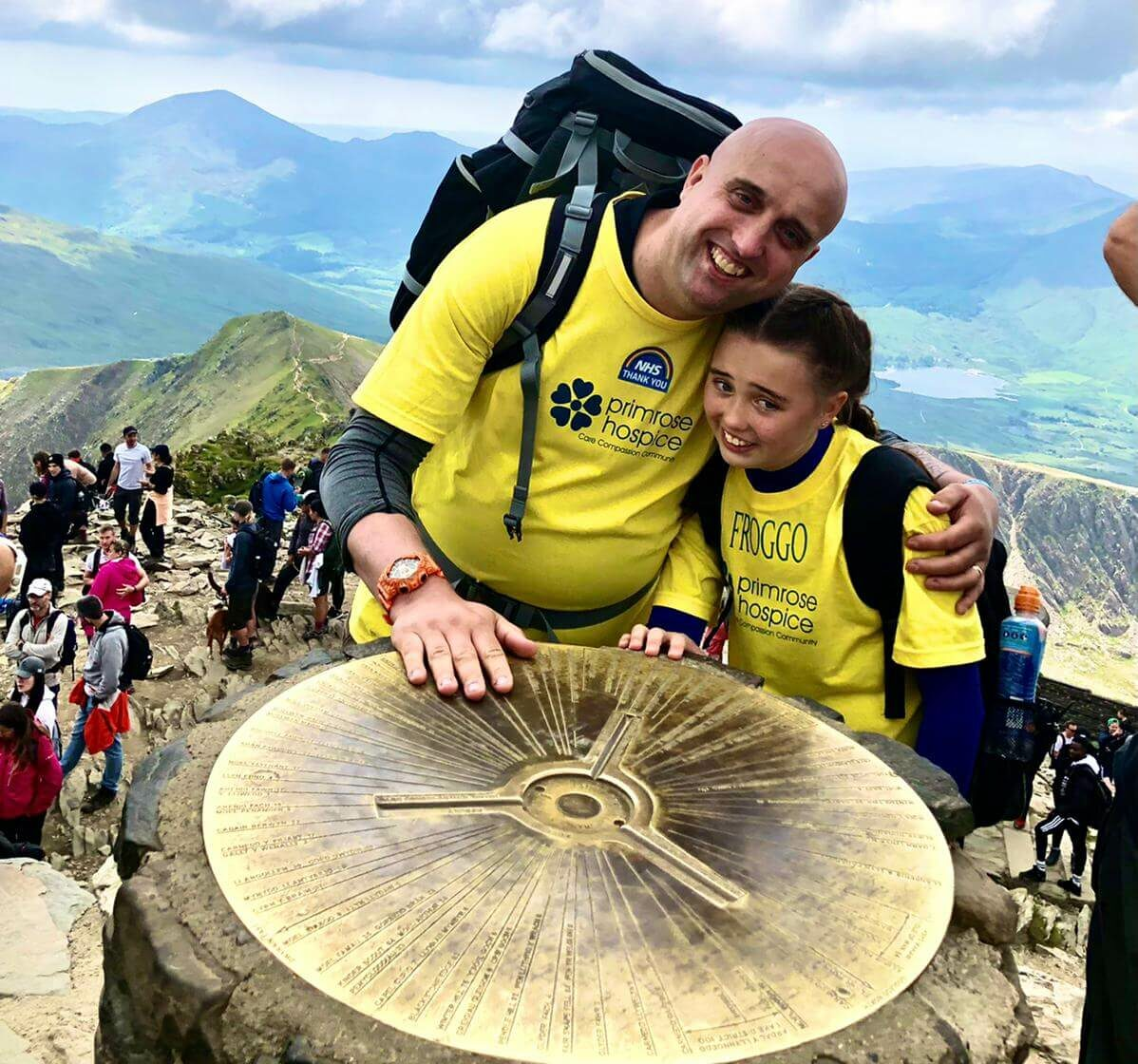 Dad Leighton with his daughter Chloe in Primrose Hospice t-shirts at the summit of Mount Snowdon